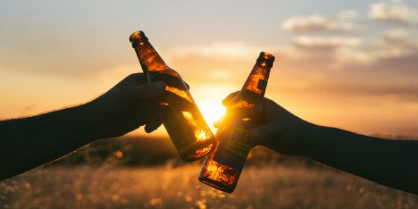 Beer bottles toasting in the sun